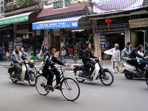 Crossing the busy streets of Hanoi can be a challenge. Photo by redpolkadot.