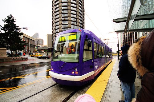 Seattle's streetcar, a.k.a. the South Lake Union Trolley (affectionately abbreviated as S.L.U.T.), not only moves people but also moves ideas. Photo by WintrHawk.