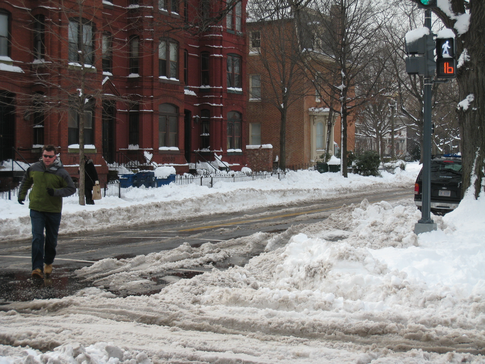 A brave soul navigates around snow drifts in Logan Circle, two days after snow stopped falling in Washington, D.C. Photo by Erica Schlaikjer.