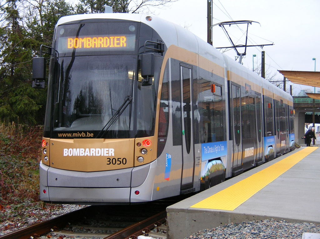 Now that the Olympics are over, transit advocates are raving about its record transit ridership and pushing for temporary improvements, such as the streetcar above, to be sustained.  Photo: Stephen Rees, flickr.