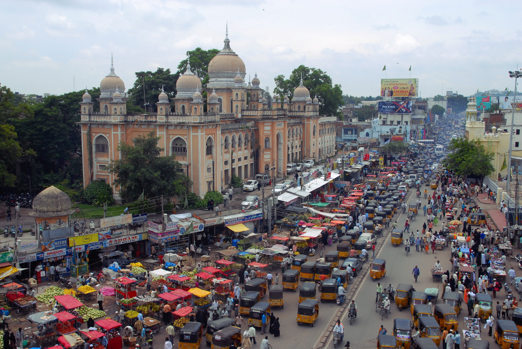 How will auto rickshaws (the black-topped vehicles in the center of the roadway) fit into tomorrow's transportation systems in Indian cities?  Photo: jaroslavd.