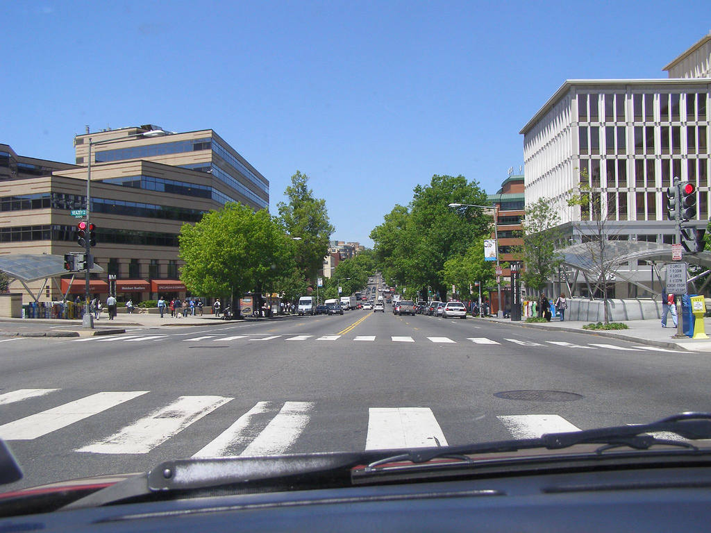 The wide lanes of Connecticut Ave, combined with heavy traffic and short pedestrian crossing times, make for a dangerous environment for walkers.  Photo: mad african! (broken sword).