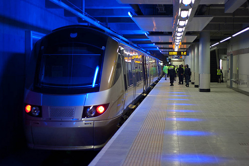 The Gautrain under its blue lights at Sandton Station, one of four open stations on the high-speed train's airport route. Photo via fmgbain.