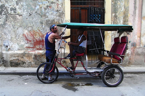 "A ""bicitaxi"" sits idle in Havana, Cuba. The new bicycle-powered phone charger could provide extra business for bicitaxi riders. Photo via designwallah-flâneur."