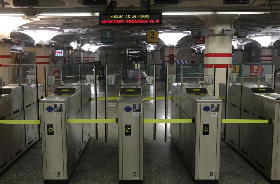 Closed turnstiles at Sol metro station, a central transit hub in Madrid. Photo via El Pais.