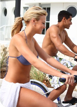 Decobike's website features sculpted South Beachers happily pedaling. Photo via Decobike.