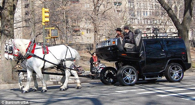 "New York artist Jeremy Dean converted a Hummer H2 into a horse-drawn carriage to ""show how screwed and unsustainable the auto industry has become."" Photo via WagingNonViolence.com."
