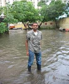 Embarq intern Vig Krishnamurthy wades through street nearby CST-India office in Mumbai. Photo via Tahira Thekaekara.