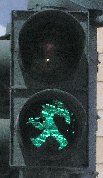 Some days, the little traffic light man needs an umbrella. Photo via Wikipedia.
