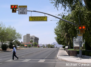 "A hawk crossing in Tucson. Overhead signage announces ""pedestrian crossing."" Photo via saferoutesinfo.org"