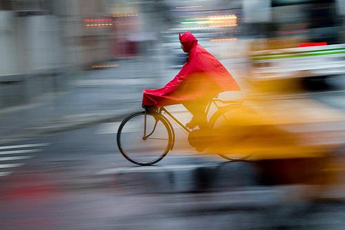 Don't let the rain spoil your morning bike commute. Photo via jrodmanjr.