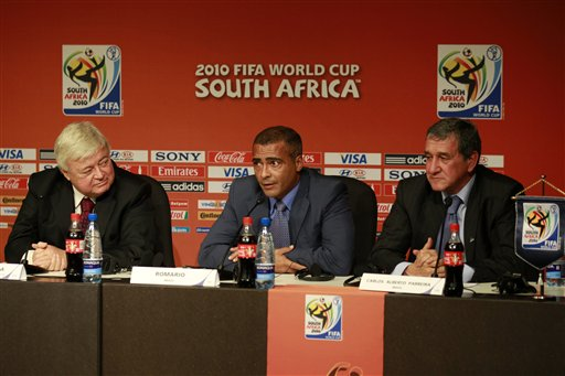Today, July 8, Brazilian Football Federation (CBF) president Ricardo Teixeira, former star striker Romario, and the Brazilian coach of South Africa's 2010 national team, Alberto Parreira, participated in the launch of the official logo for the 2014 World Cup. Photo via Associated Press.