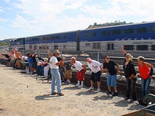It happens only once a year! Participants flash some flesh at a passing Amtrak train. Photo by Chuck Coker.