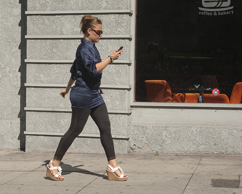 Increasingly, pedestrians are hurting themselves - or at least their egos - while texting (or talking) and walking. Image via NoHoDamon.