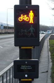 Toucans are used in the UK to allow cyclists to cross with pedestrians. They use on-crossing detectors, like puffins, and cost about the same as puffins to install. Photo via newcastle.gov.uk.
