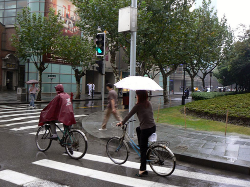 Worst case scenario: hold an umbrella while you ride! It is possible. Photo by Ol.v!er [H2vPk].