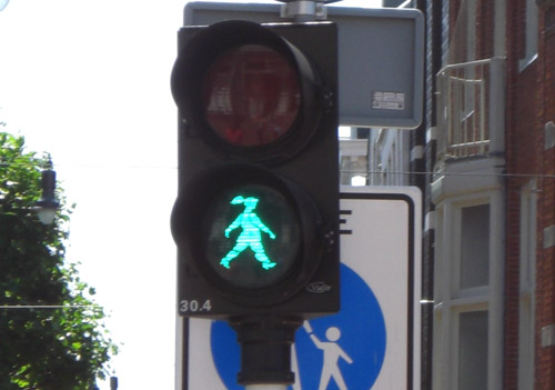 Utrecht, in the Netherlands, features Sophie, the pony-tailed female walk signal. Proponents of female walk signals say people pay more attention to the curvier figures.