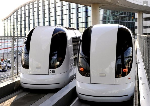 Two vehicles run on the guideway of London Heathrow's Terminal 5 for the first time. Photo via ULTra PRT.