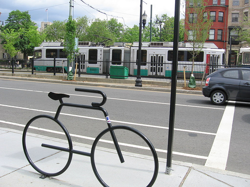 "A bike-shaped bike rack outside a Boston ""T"" subway line. Photo by straightedge217."