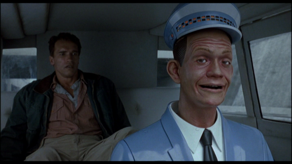 Would you trust yourself with a robot—like Total Recall's Johnny Cab—behind the wheel? Image via cracked.com.