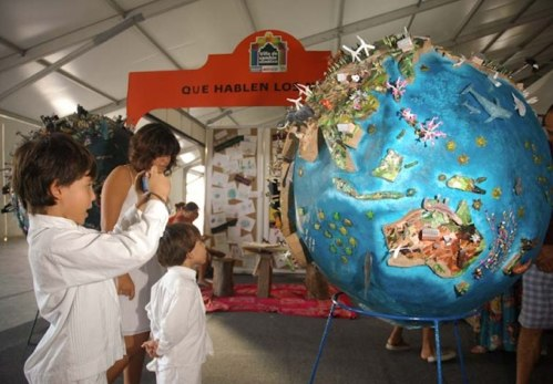 Children imagine a low-carbon world at the Climate Change Village in Cancun, Mexico. Photo via COP16/CMP6 website.