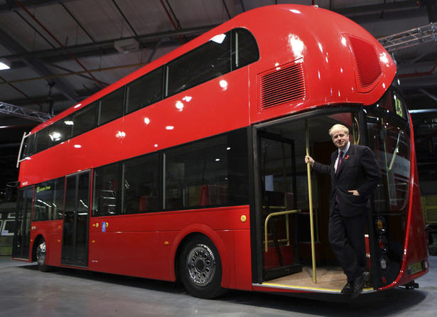 London's Mayor Boris Johnson shows off a full-scale model of the city's new double-decker bus. Photo via Reuters.