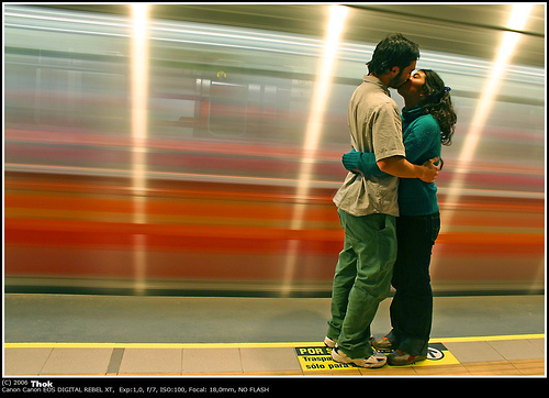 A young couple steals a kiss on the platform of Quilin station in Santiago, Chile. Photo by Thokrates.