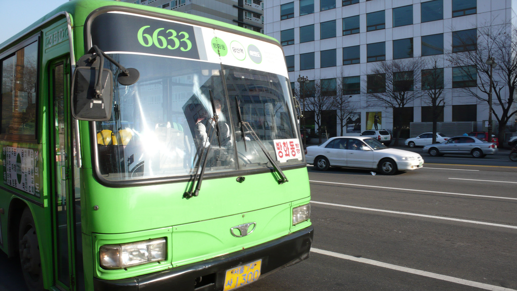 Seoul's color coded buses simplify route identification and encourage bus ridership. Photo by Jon Allen.
