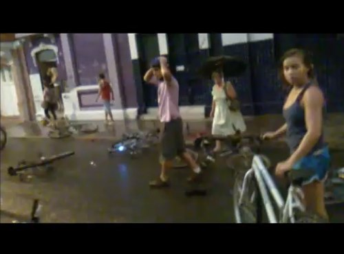 Critical Mass riders are shocked at the aftermath of the event. Image via YouTube.