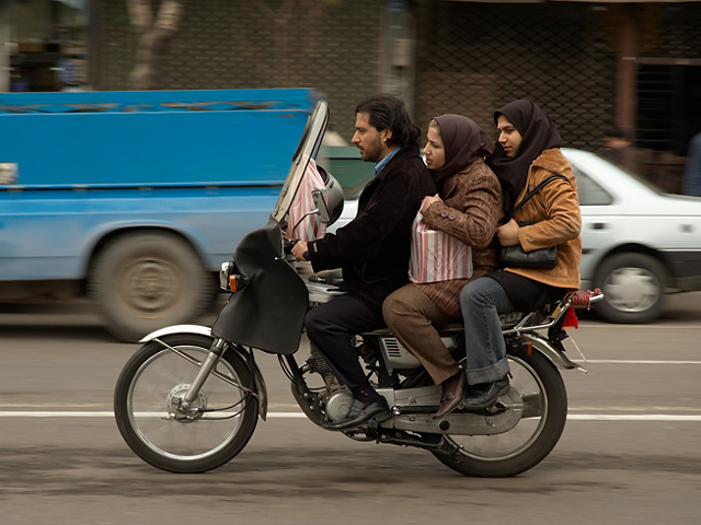 Family on the streets of Tehran. Photo by kamshots.