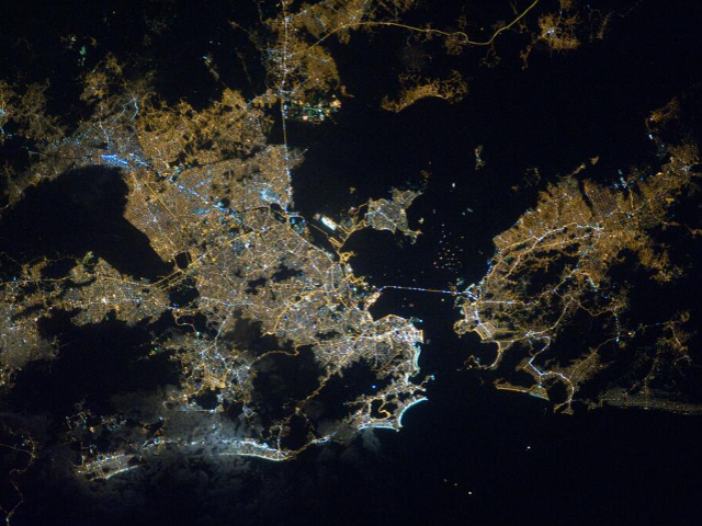 Downtown Rio de Janeiro shines at night in this photo tweeted from the International Space Station. Photo courtesy of @ESRIlabs.