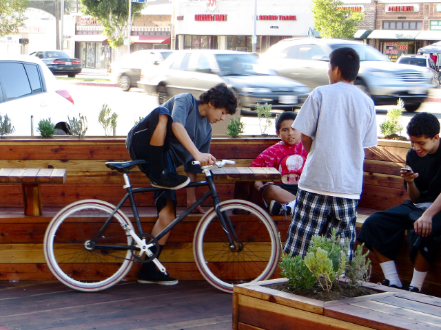Boys gather in a parklet