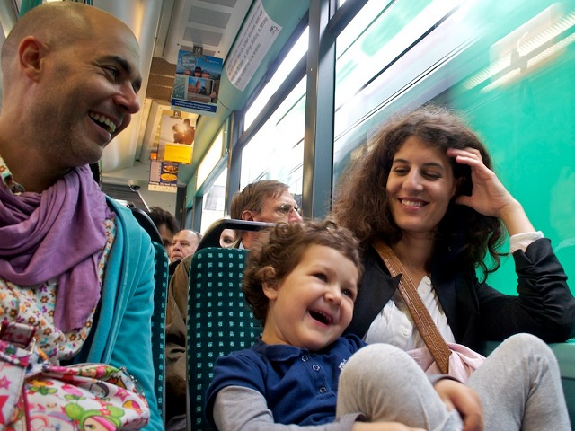 A family travels by train in Germany. Photo by Edo Medicks/Flickr.