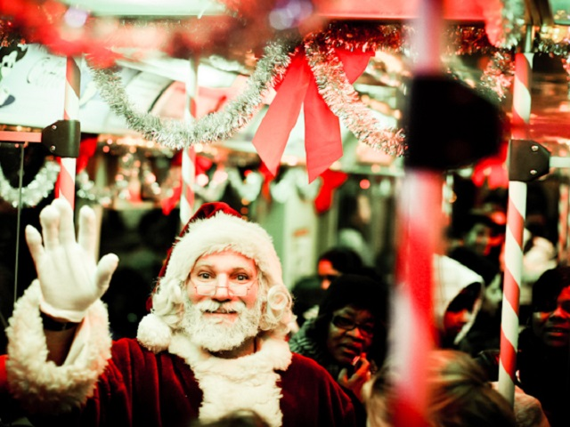 "Santa waves from Chicago's ""Santa Train."" Photo by Boqiang Liao/Flickr."