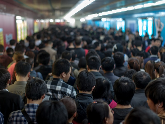 Rush hour at Guomao Station on the Beijing subway. Photo by Jens Schott Knudsen/Flickr.