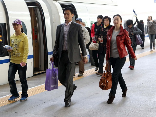 Passengers disembark from a train in Tianjin, China. Photo by Yang Aijun/WorldBank/Flickr. Cropped.