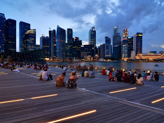 A crowd gathers overlooking Singapore's Marina Bay. Photo by Nicolas Lannuzel/Flickr.