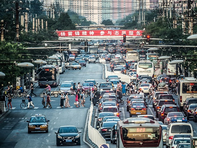 Although congestion pricing is often a contentious issue, its ability to decrease congestion and air pollution while increasing revenue for sustainable transport projects makes it a policy many cities find worth pursuing. Photo by Zhou Ding/Flickr.
