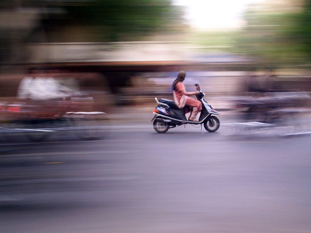 """As the two-wheeler sector continues to expand in India, researchers study the demographics of two-wheeler users and their possible role in promoting sustainable mobility. Photo by Meghana Kularni/Flickr."""""""