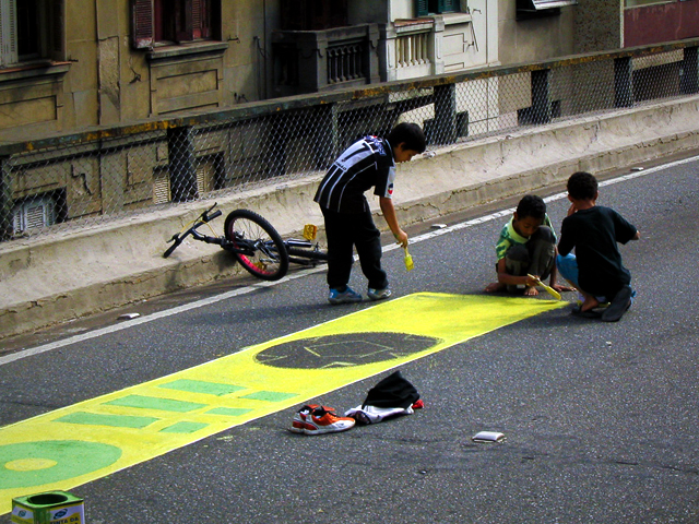 Painting the streets in honor of the World Cup is community tradition in cities across Brazil, and one for all ages. Photo by Dylan Passmore/Flickr.