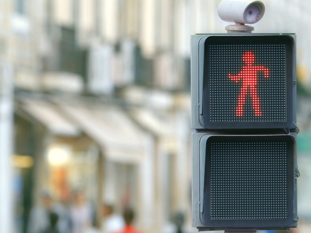 A new way to encourage pedestrians not to cross in the face of oncoming traffic: entertain them. Photo via smart/Youtube.