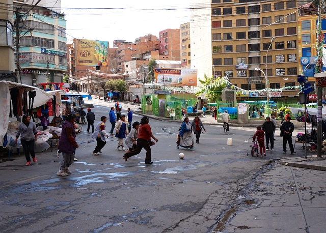 Vendors near Plaza Eguino, the heart of La Paz's main market district, take advantage of the quiet day to play soccer. Photo by Gwen Kash.