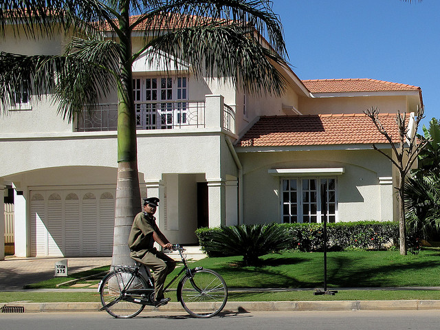 Gated communities are on the rise on Bangalore's periphery. As demand for housing increases and incomes rise across Indian cities, private developers play an important role in promoting sustainable development by ensuring access to alternative modes of transport. Photo by Ed Yourdon/Flickr.