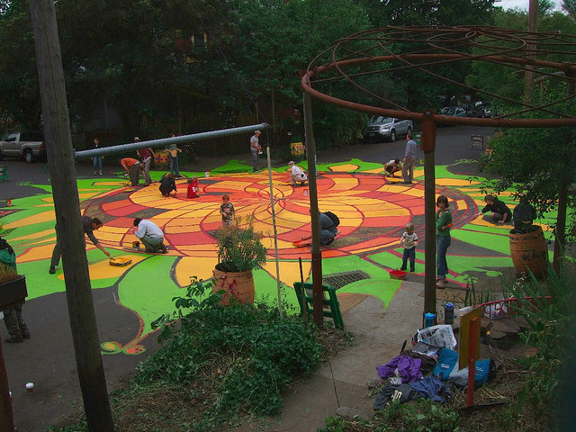"""In Portland, Oregon, an organization called """"City Repair"""" paints a street mural. Photo by City Repair/Flickr."""